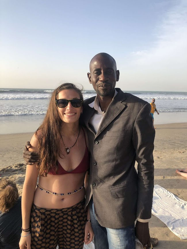 Mamadou and Clara Sherwood on a beach in The Gambia